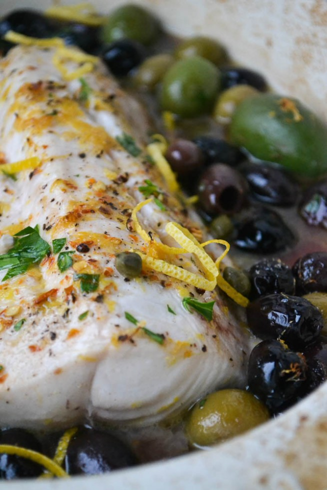 Baked fish with lemon and olives