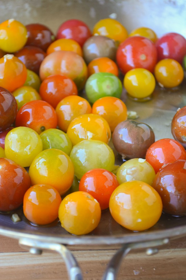cherry tomatoes in a skillet for Bucatini with Burst Tomatoes