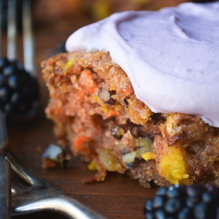 carrot and pineapple snack cake with blackberry frosting