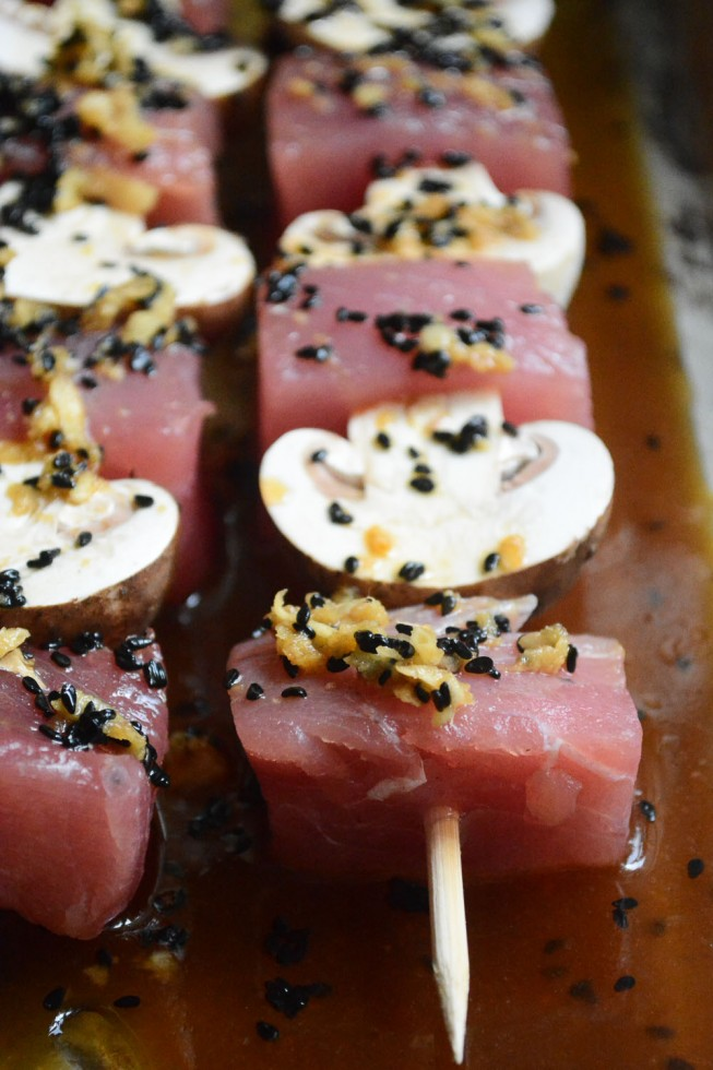 marinating ahi tuna and cremini skewers with a ginger and sesame sauce