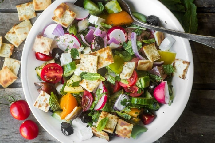 Middle Eastern Fattoush Salad on a wooden table