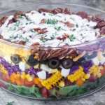 Easy to asemble and healthy Layered Rainbow Salad can be made a head before a picnic, potluck, or barbecue.