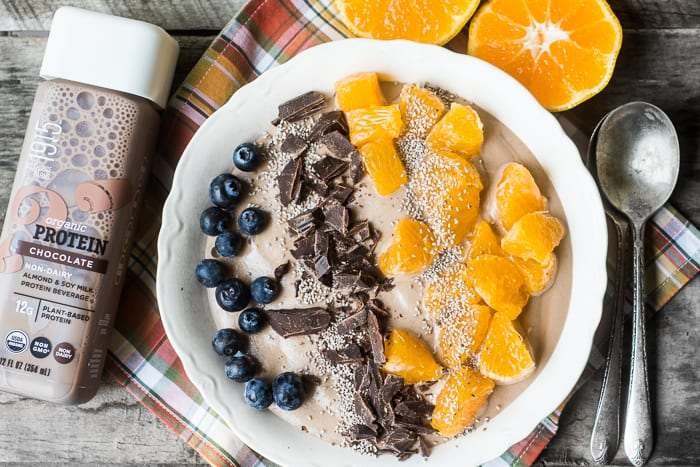 Chocolate banana Vegan Breakfast Bowl with oranges, white chia seeds, and raw chocolate | theviewfromgreatisland.com