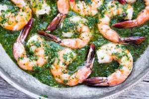 Easy and healthy Chimichurri Shrimp appetizer or light meal ~ serve it over greens for a low carb paleo dish, or with bread or pasta for some serious comfort food. ~ theviewfromgreatisland.com