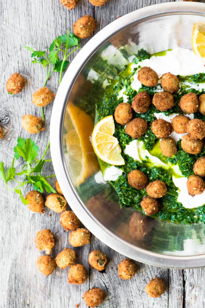 Fried Olives with Spicy Yogurt ~ are you ready for a new taste sensation? The olives are crispy on the outside, warm and juicy inside, the yogurt is cool and creamy, and the herb sauce is zesty. It's a party in the mouth and you're going to love it!