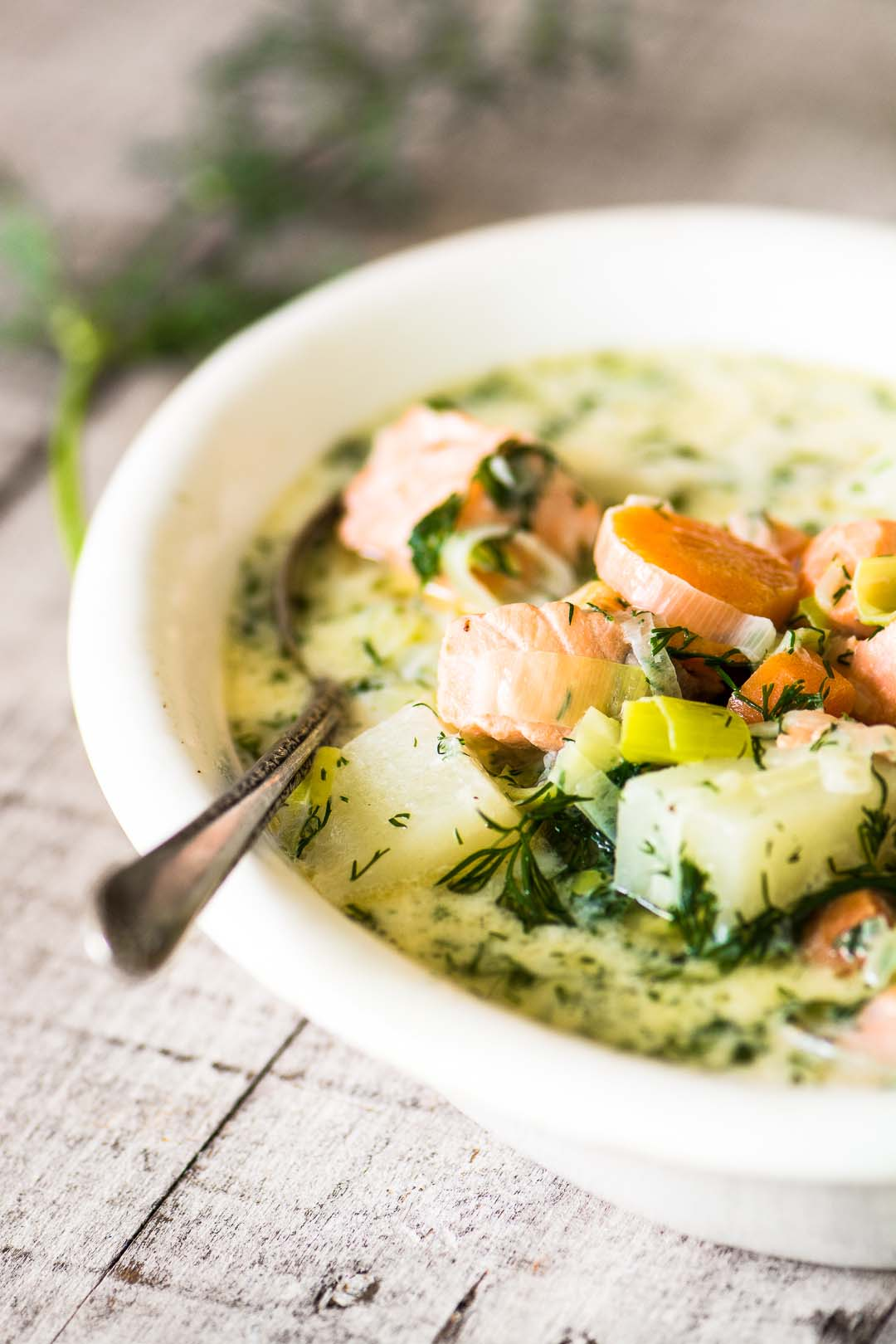 Finnish Salmon Soup – Lohikeitto ~ in a white bowl