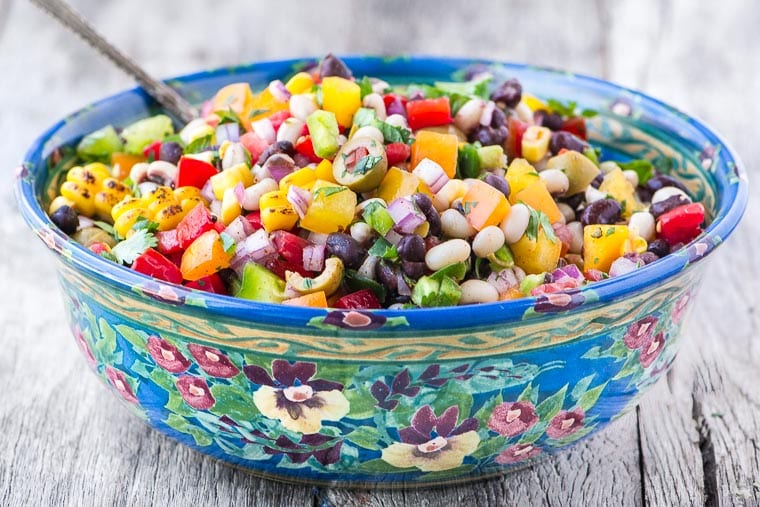 Cowboy Caviar in a blue bowl with spoon