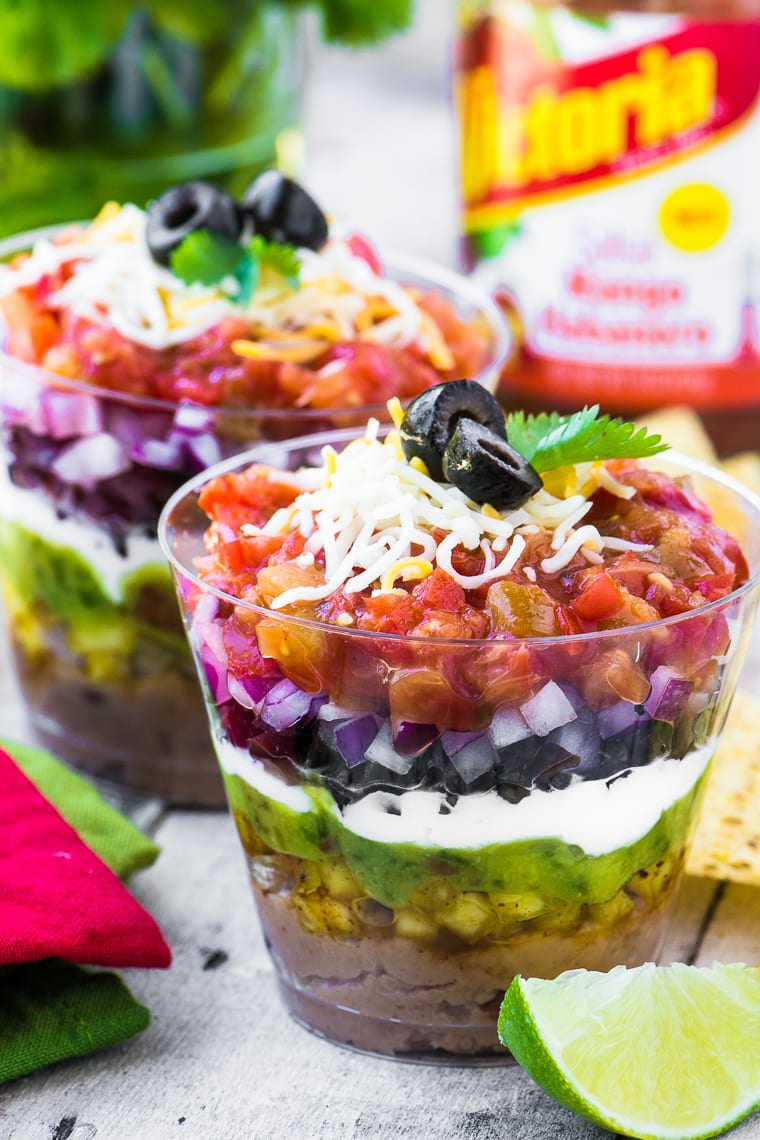 These colorful 7 Layer Dip Cups are portable little appetizer stations layered up just like everybody's favorite Tex-Mex bean dip ~ so you can mingle and chow down at the same time ~ genius!