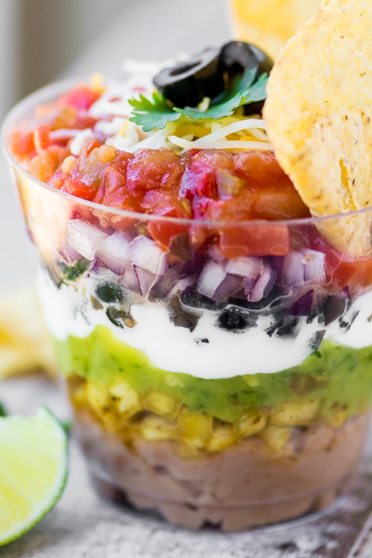 These colorful 7 Layer Dip Cups are portable little appetizer stations layered up just like everybody's favorite Tex-Mex bean dip ~ perfect for any party, picnic, or barbecue!