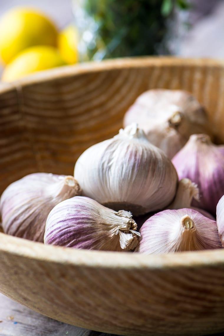 purple garlic cloves in a bowl