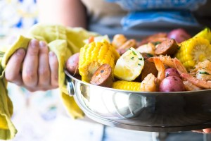 Low Country Shrimp Boil ~ this iconic Southern feast is the ultimate one pot meal ~ Vidalia onions, potatoes, corn, Andouille sausage, and shrimp get layered into a large stock pot with Cajun spices ~ just add friends and lots of ice cold beer!