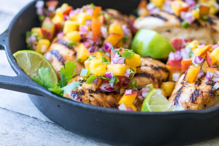 Grilled Chicken with Peach Jalapeño Salsa ~ this lightning quick meal is low calorie, low fat, low carb, gluten free, Whole 30 and Paleo compliant, not to mention Weight Watchers friendly. But more importantly, it's healthy and insanely delicious.