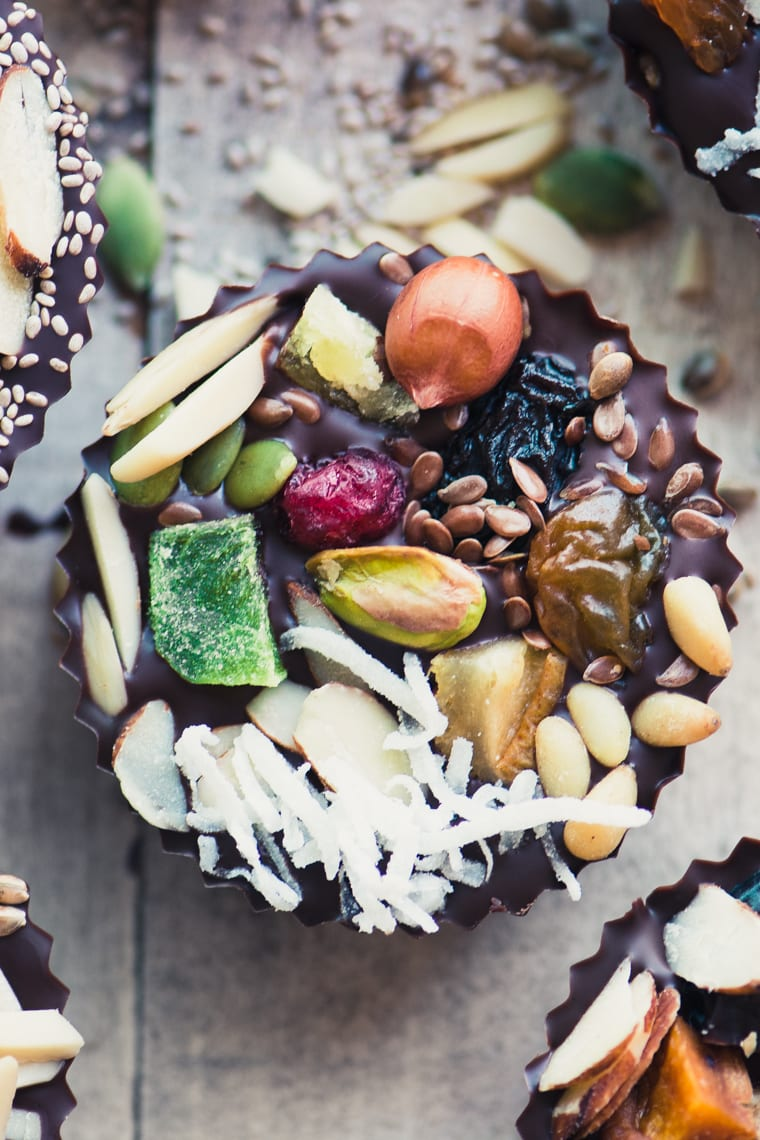 A Detox Dark Chocolate Almond Butter Cut topped with dried fruit, nuts, and seeds