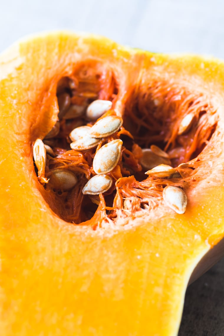 How to Roast Squash Seeds ~ five ways! A butternut squash, sliced in half