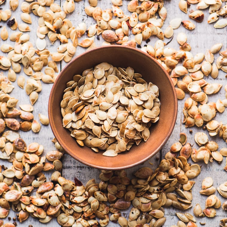 How to Roast Squash Seeds ~ five ways! A bowl of winter squash seeds, toasted and spiced