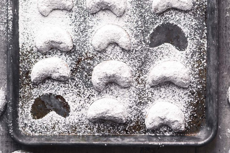 Cardamom Crescent Cookies on a baking sheet