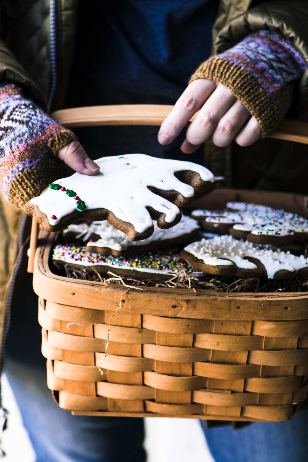 Girl holding a basket of Easy Gingerbread Cookies with Royal Icing