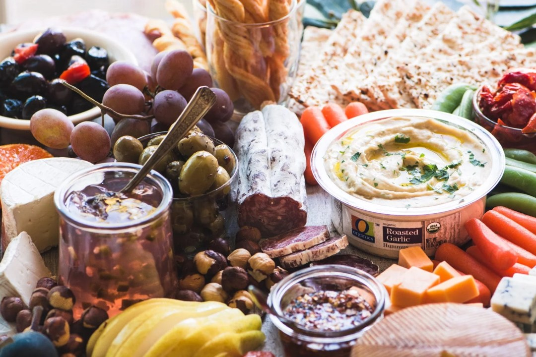 How to Make the Ultimate Cheeseboard with olives, cheeses, spreads, and more.