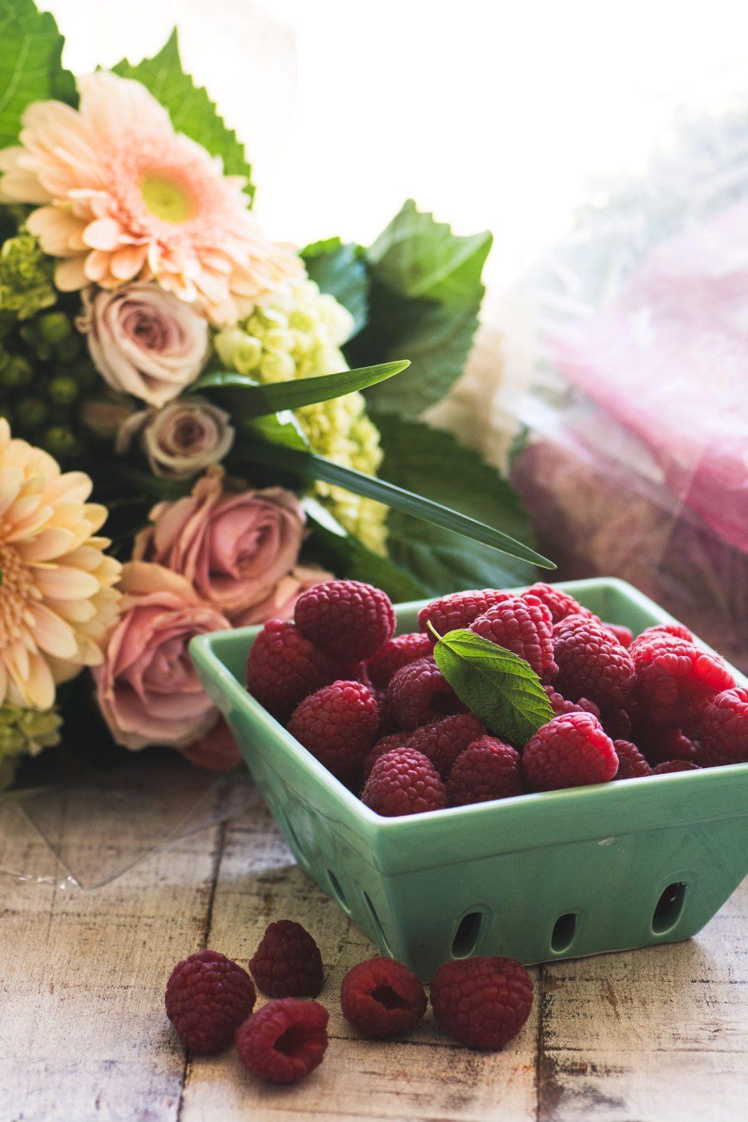 fresh flowers and raspberries