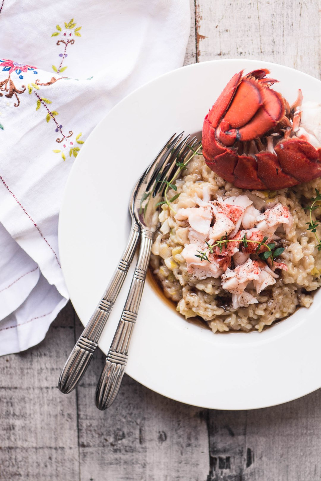 Instant Pot Lobster Risotto with forks and a napkin