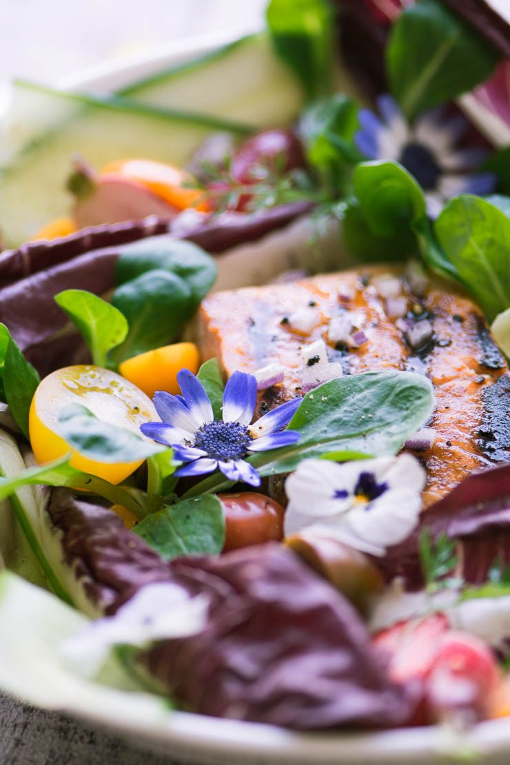 Grilled salmon salad with spring greens and edible flowers