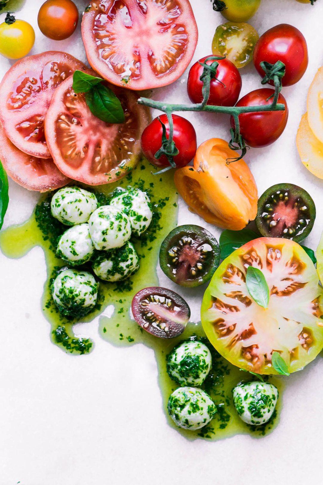 Basil marinated mozzarella with colorful summer tomatoes