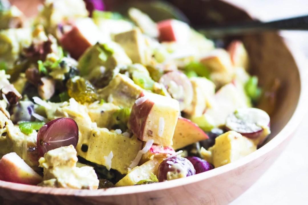 Curried chicken waldorf salad in a wooden bowl