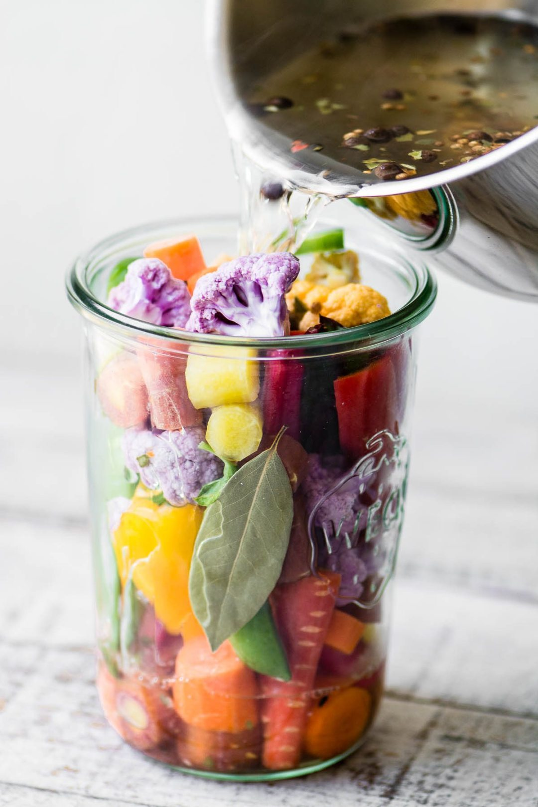 Quick Pickled Rainbow Giardiniera ~ Pouring hot brine into a jar of colorful giardiniera