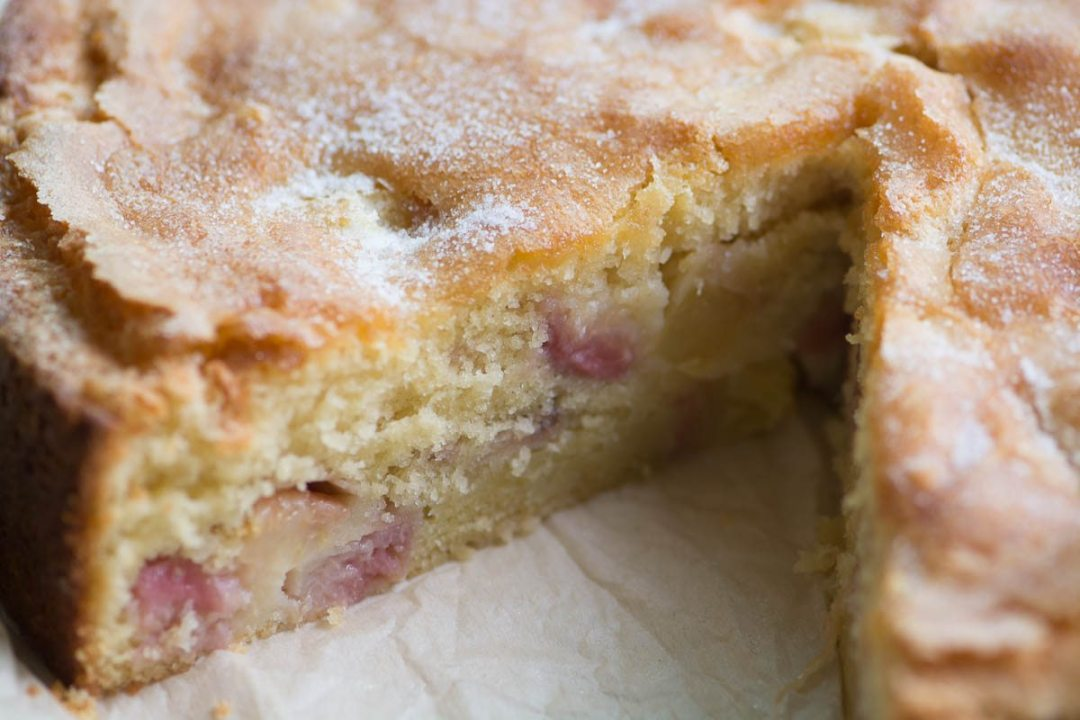 Closeup of peaches and cream breakfast cake with slice removed