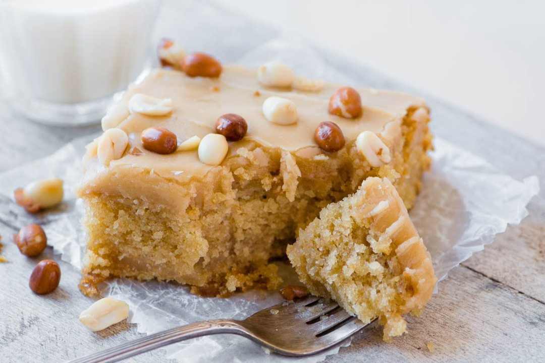 A slice of old fashioned peanut butter cake with fork