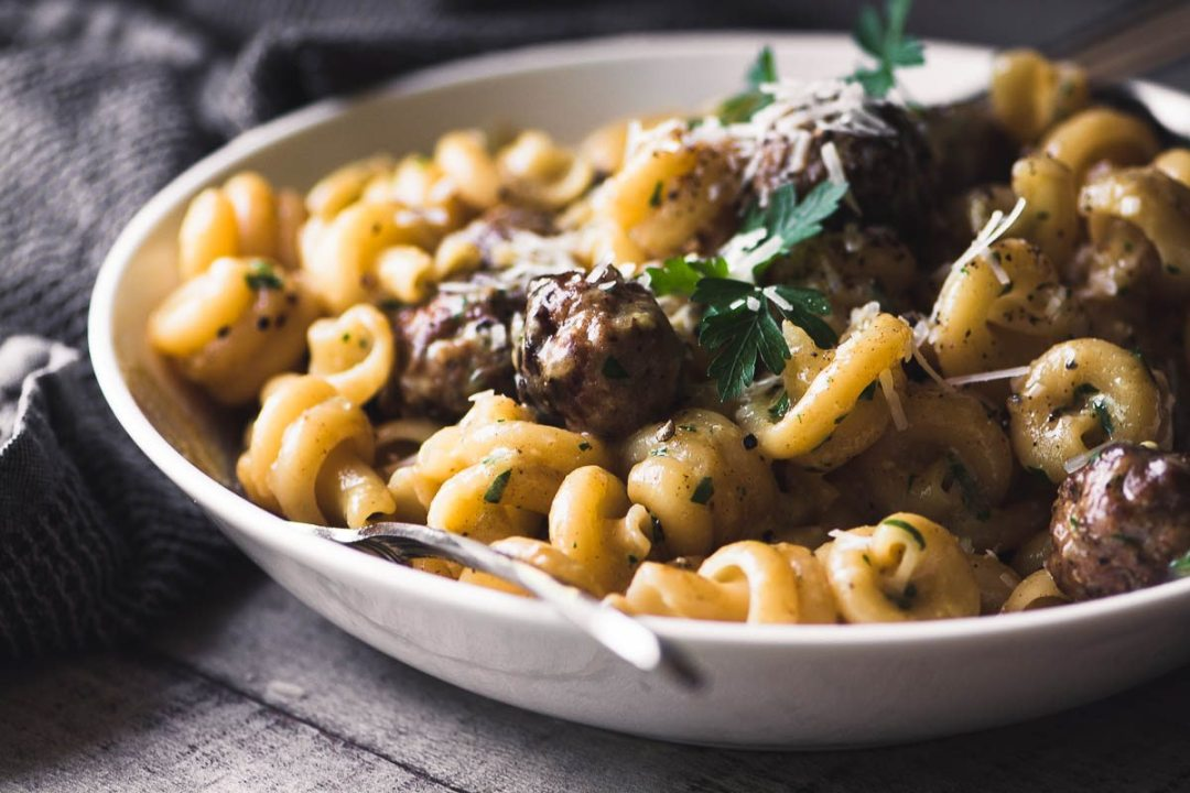 Jamie Oliver's Easy Sausage Carbonara pasta in a white bowl