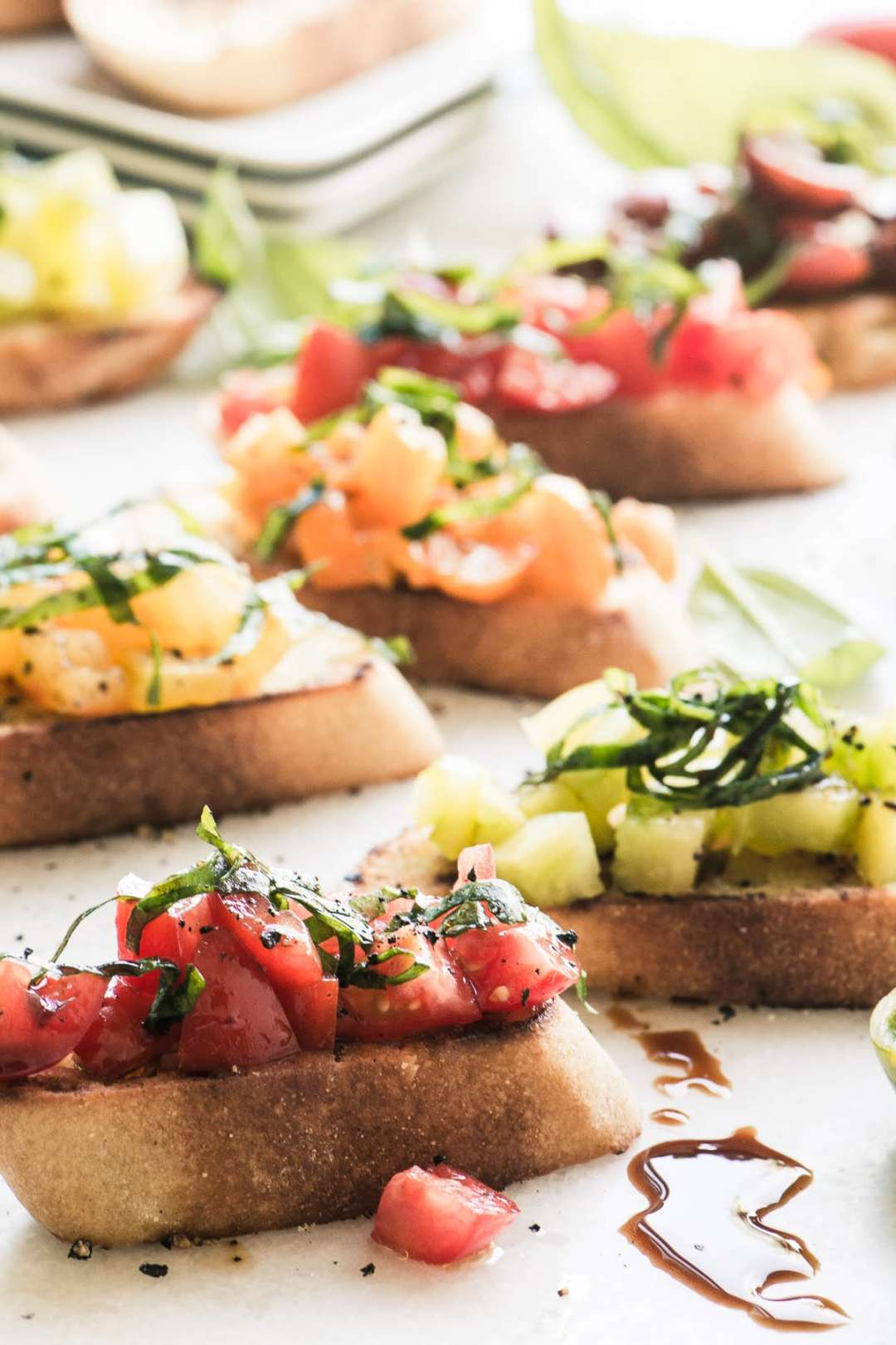 Colorful Heirloom Tomato Bruschetta on a white surface