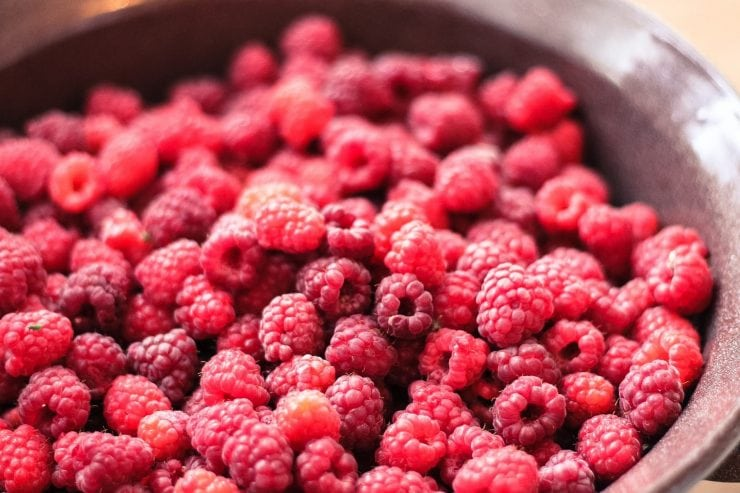 wild raspberries in a bowl