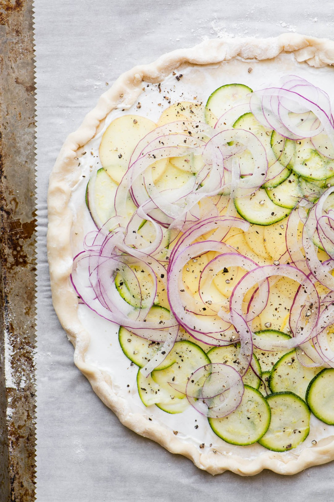 savory goat cheese and summer squash tart ready to bake