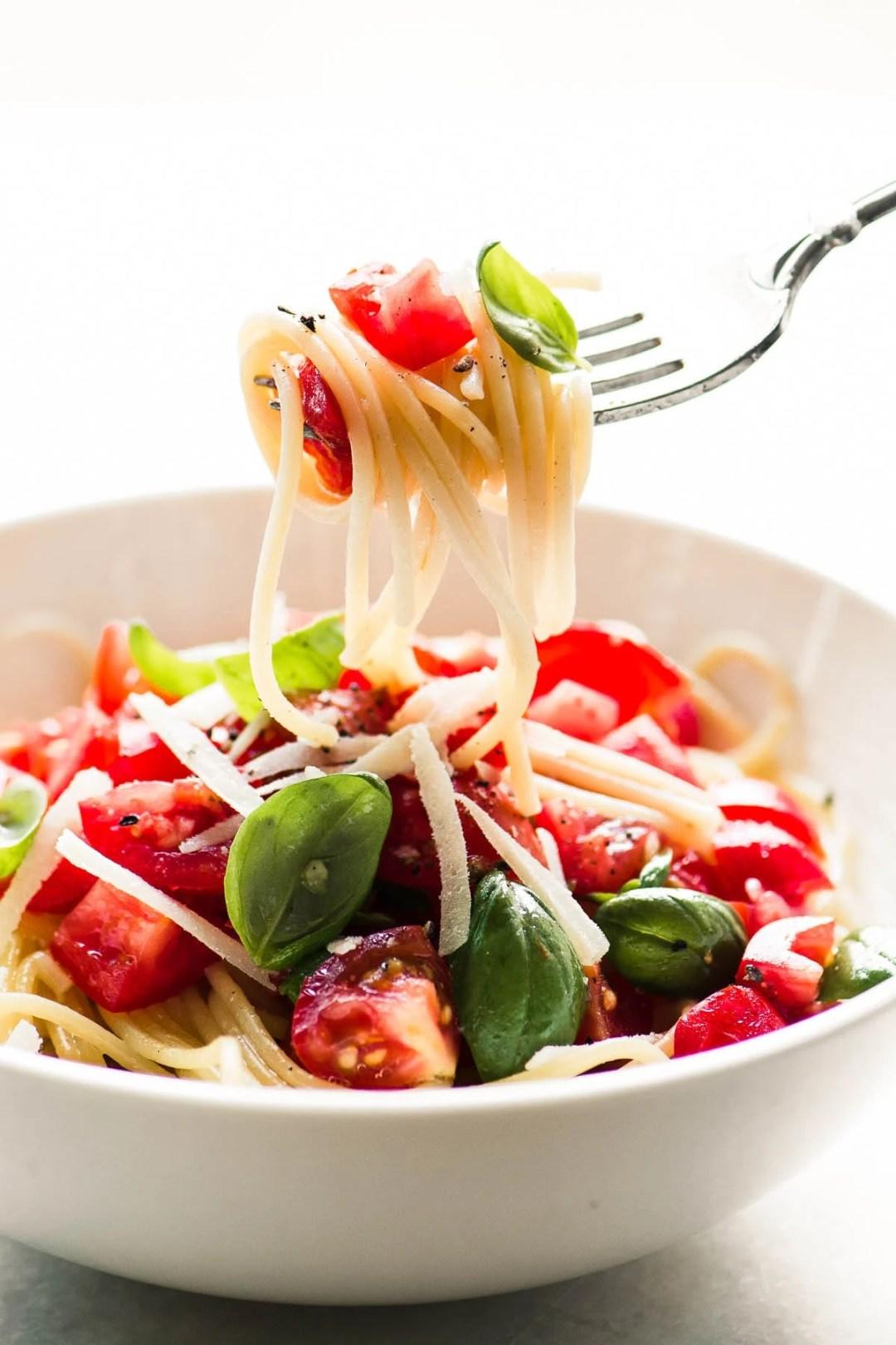 A bowl of pasta alla checca with fork