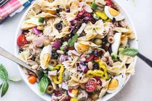 Mediterranean Pasta Salad with Tuna in a white bowl