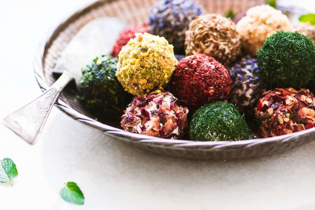 A bowl of colorful Jewel Box Labneh Balls