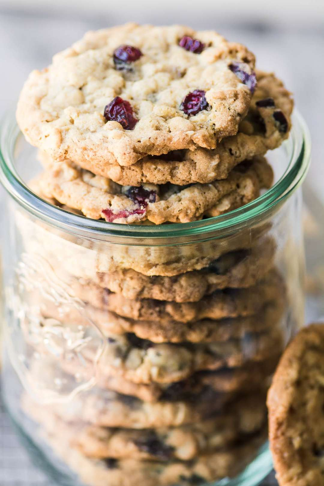 old fashioned oatmeal cranberry cookies in a mason jar