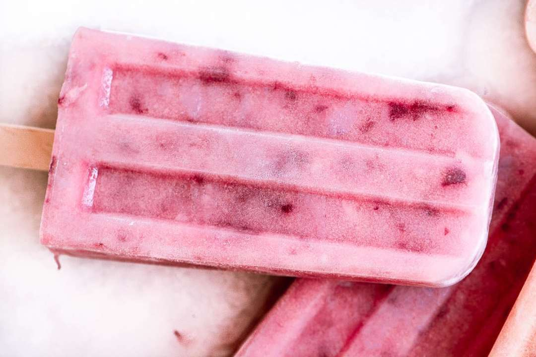 white peach popsicles on a white surface