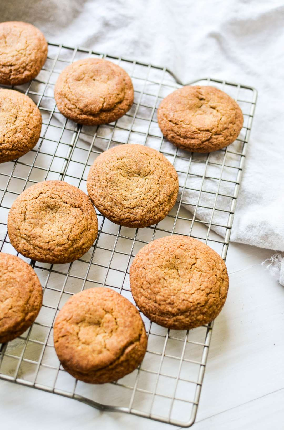 Gingerbread Snickerdoodles cooling on a rack.