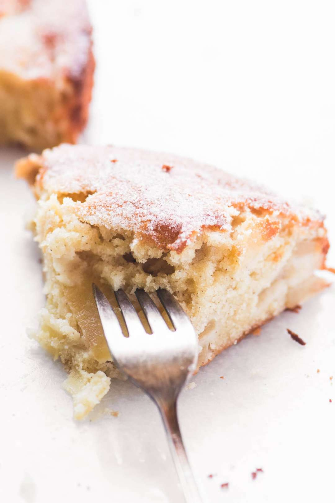 Taking a bite out of a slice of Dutch Apple Cake.