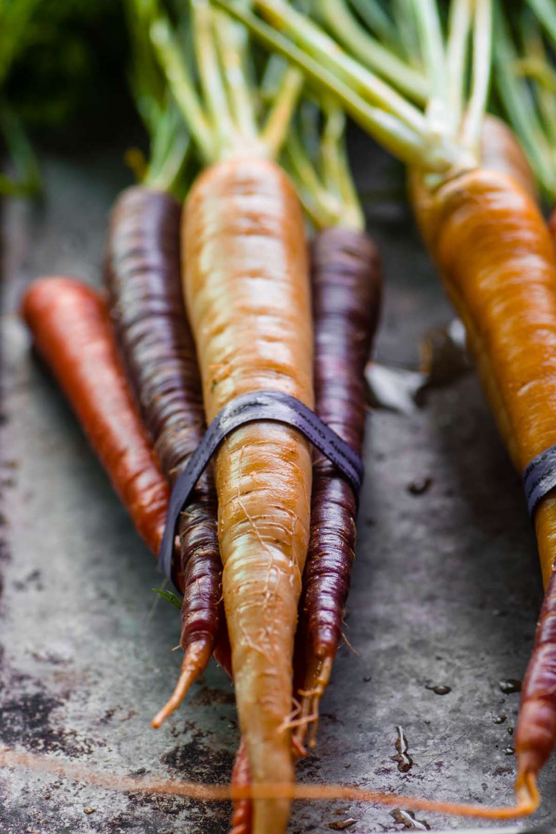 A bunch of rainbow carrots