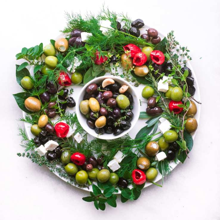 Festive Olive and Herb Wreath on a white platter