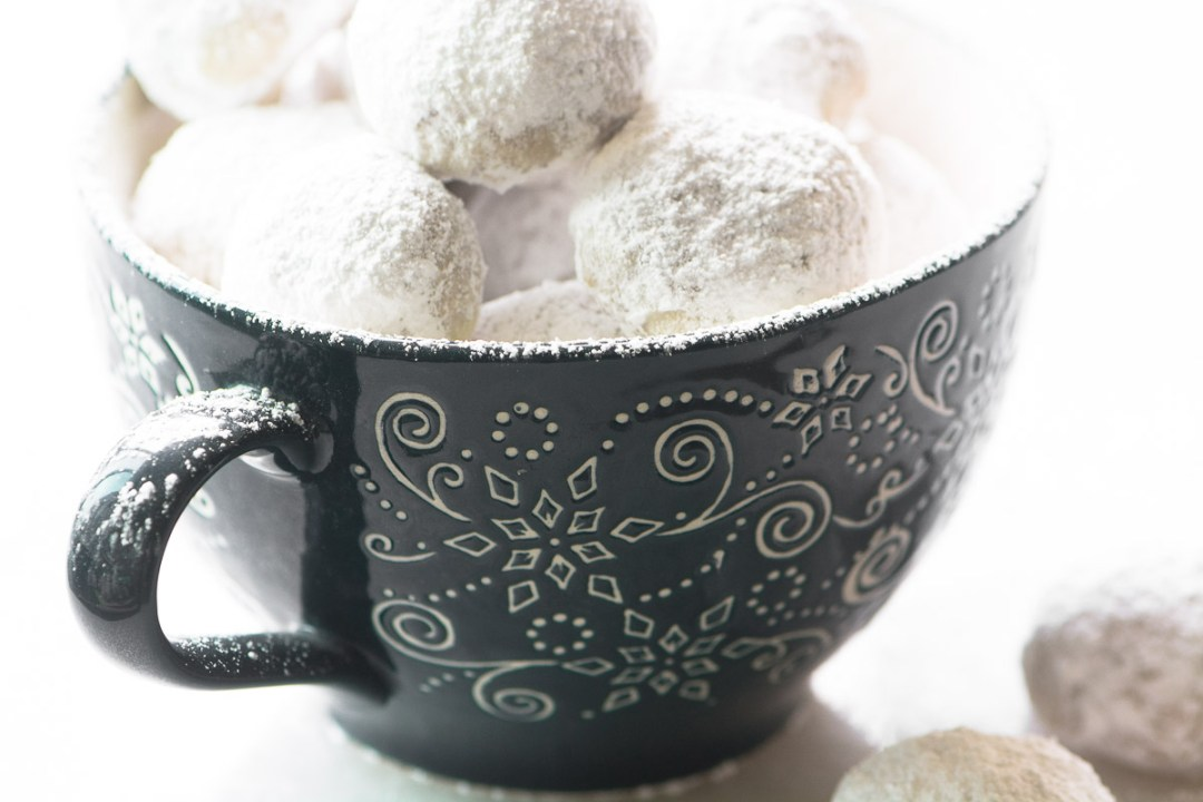Toasted Almond Russian Tea Cakes in a mug