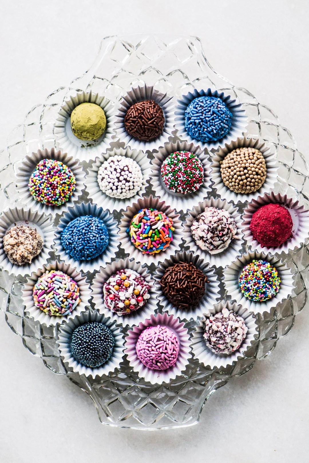 A glass platter of jewel box truffles
