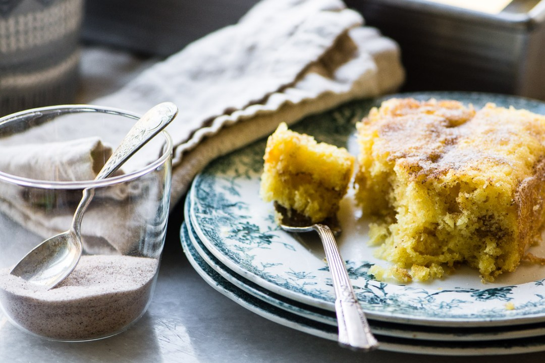 Super easy cinnamon coffee cake on a blue plate with fork