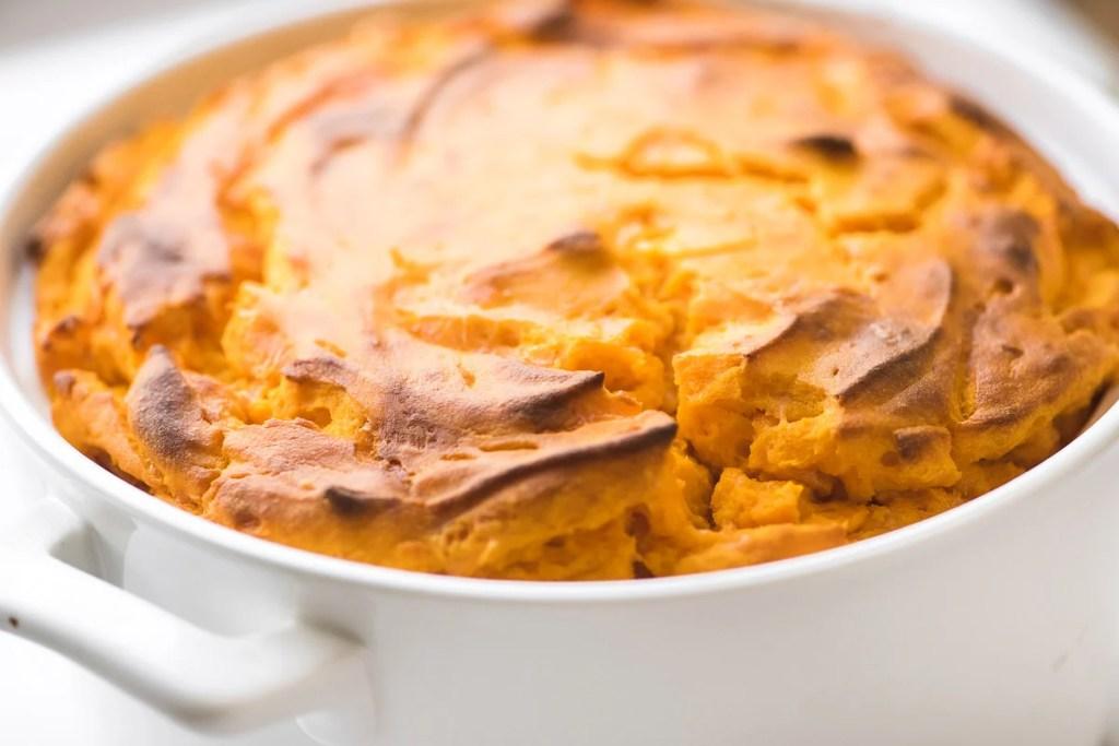 Carrot Soufflé in a white casserole dish