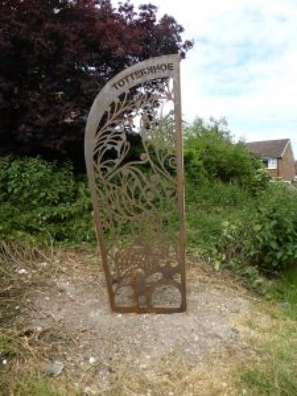 """Central Bedfordshire Council, with the support of Sustrans, has installed two attractive bespoke pieces of artwork on national cycling routes in locations close to Dunstable and Luton Airport.   The artwork is made from laser-cut steel, and has been designed to highlight the routes and provide attractive and prominent formal entrances which will encourage more walkers and cyclists to use the routes.  In creating the unique designs, the artist, Stephen Pardue from interpretation specialists Differentia, took inspiration from local landscapes, wildlife and the history of the sites.  The Totternhoe Green Lanes artwork is close to Dunstable on Sustrans National Cycle Route 574, at the start of the green lanes on Tring Road. These ancient green lanes allow residents fantastic access to the local countryside. The gateway is designed to attract and welcome residents, while also discouraging vehicles from parking across the path entrance.  The Upper Lea Valley Way route artwork is alongside Sustrans National Cycle Route 6, close to Luton Parkway Station and airport. The gateway has been designed to encourage more people to use the cycle route, and make it more visible.  The project, funded through Central Bedfordshire Council's lottery grant in partnership with Luton Borough Council, is the last element of the Luton-Harpenden cycleway project.  Councillor Kevin Collins, Executive Member for Planning and Regeneration at Central Bedfordshire Council, said: """"The finished pieces are unique and attractive, and feature the wildlife and history of the area. They are designed to encourage the public to use these fantastic cycle routes, and enjoy the beautiful rural scenery that Central Bedfordshire has to offer.""""  For more information on the National Cycle Network, visit: www.sustrans.org.uk."""