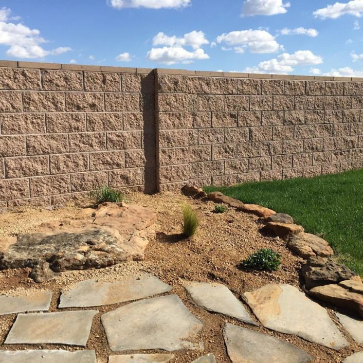 Xeriscape and grass yard surrounded by masonry fence The Vineyards Amarillo