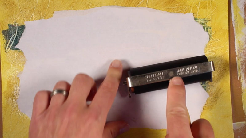 Use a brayer to secure adhesion
